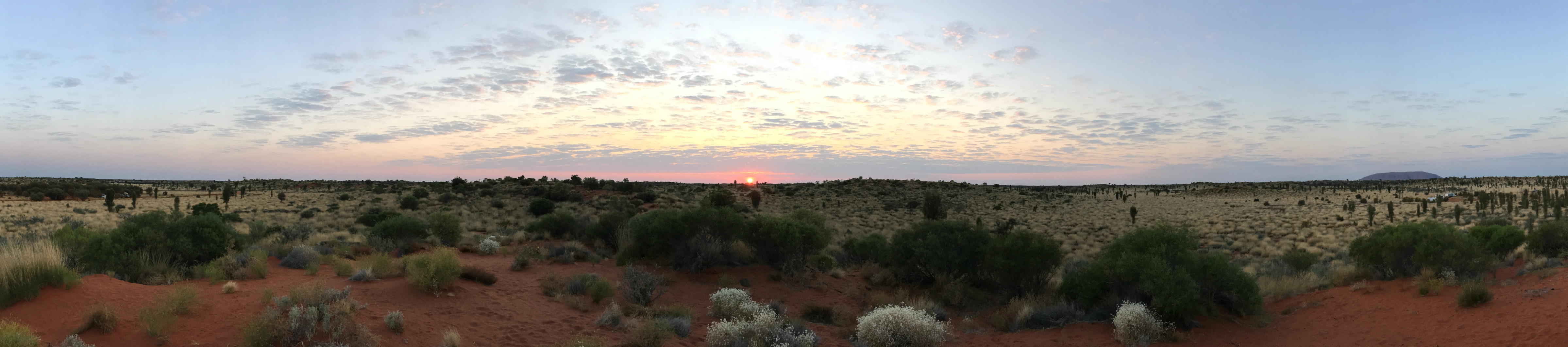 After waking up to see the sunrise, we set off early to go and cycle around Uluru.