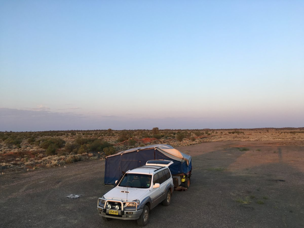 Car and tent set up at a free camp in South Australia