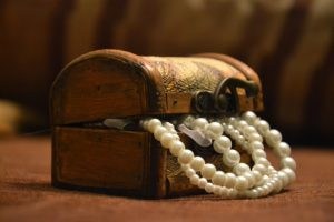 Jewellery box with a pearl necklace spilling out