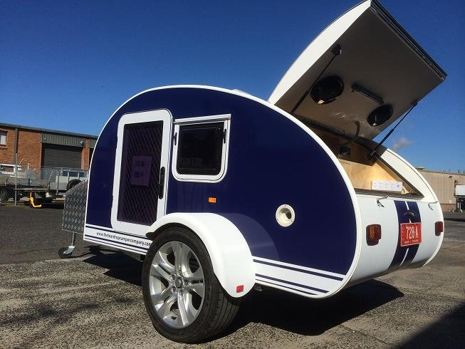 blue teardrop camper with the kitchen open