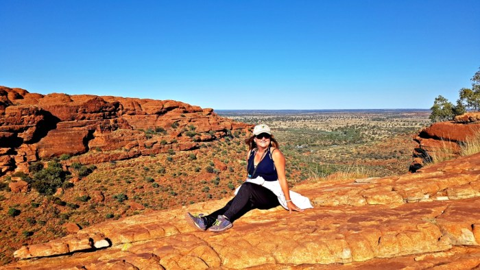Woman sitting on a rock at Kings Canyon, NT, Australia