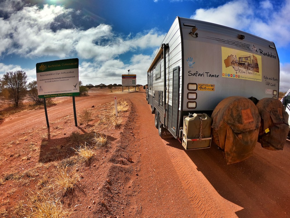 Rear view of a dusty caravan in the Australian outback