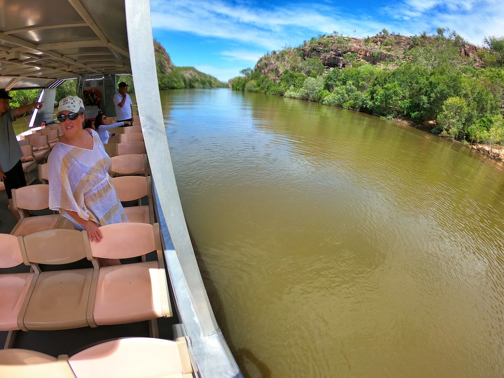Woman standing on a tour boat on a river in Northern Territory, Australia