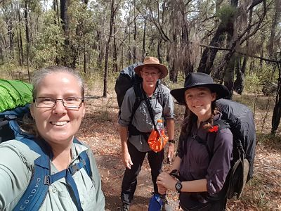 Family of 3 with hiking packs, on the Bibbulmun Track, Australia.