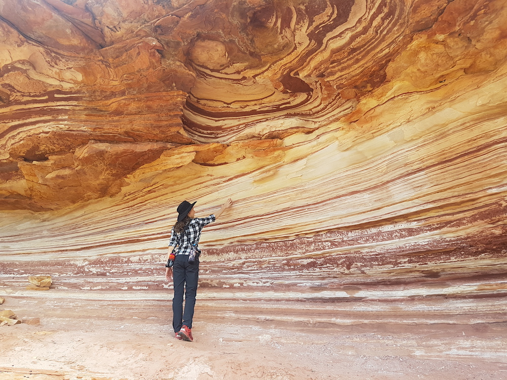 Girl observing colourful rock wall at Kalbarri