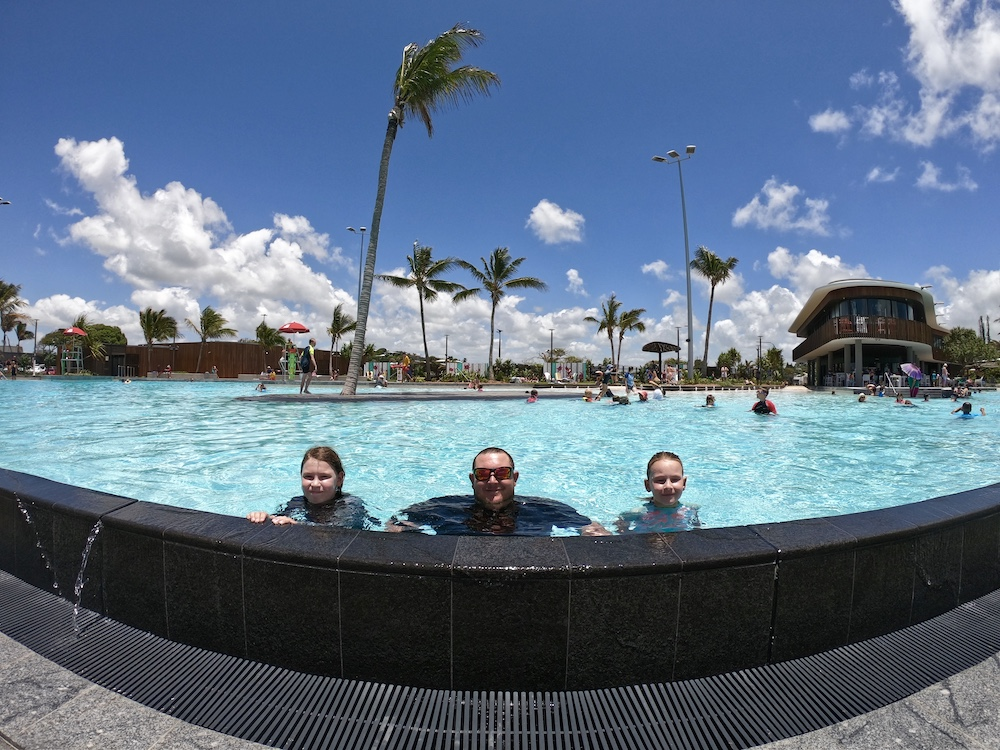 Man and two children in a large swimming pool - Australia