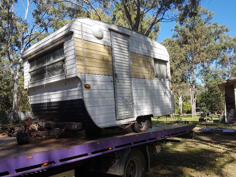 Vintage caravan sitting on a tilt tray