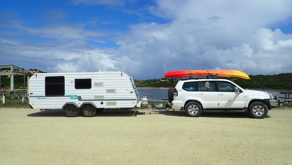 Car and caravan (with a kayak on the roof of the car) in Australia