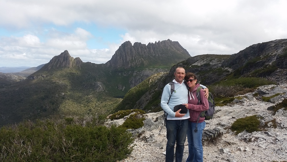 Couple standing in front of Cradle Mountain, Tasmania, Australia