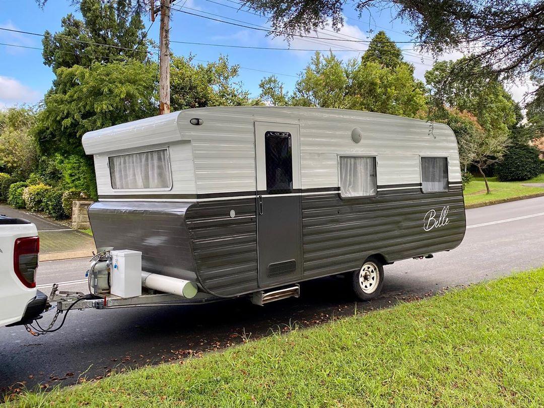 Grey and white vintage caravan