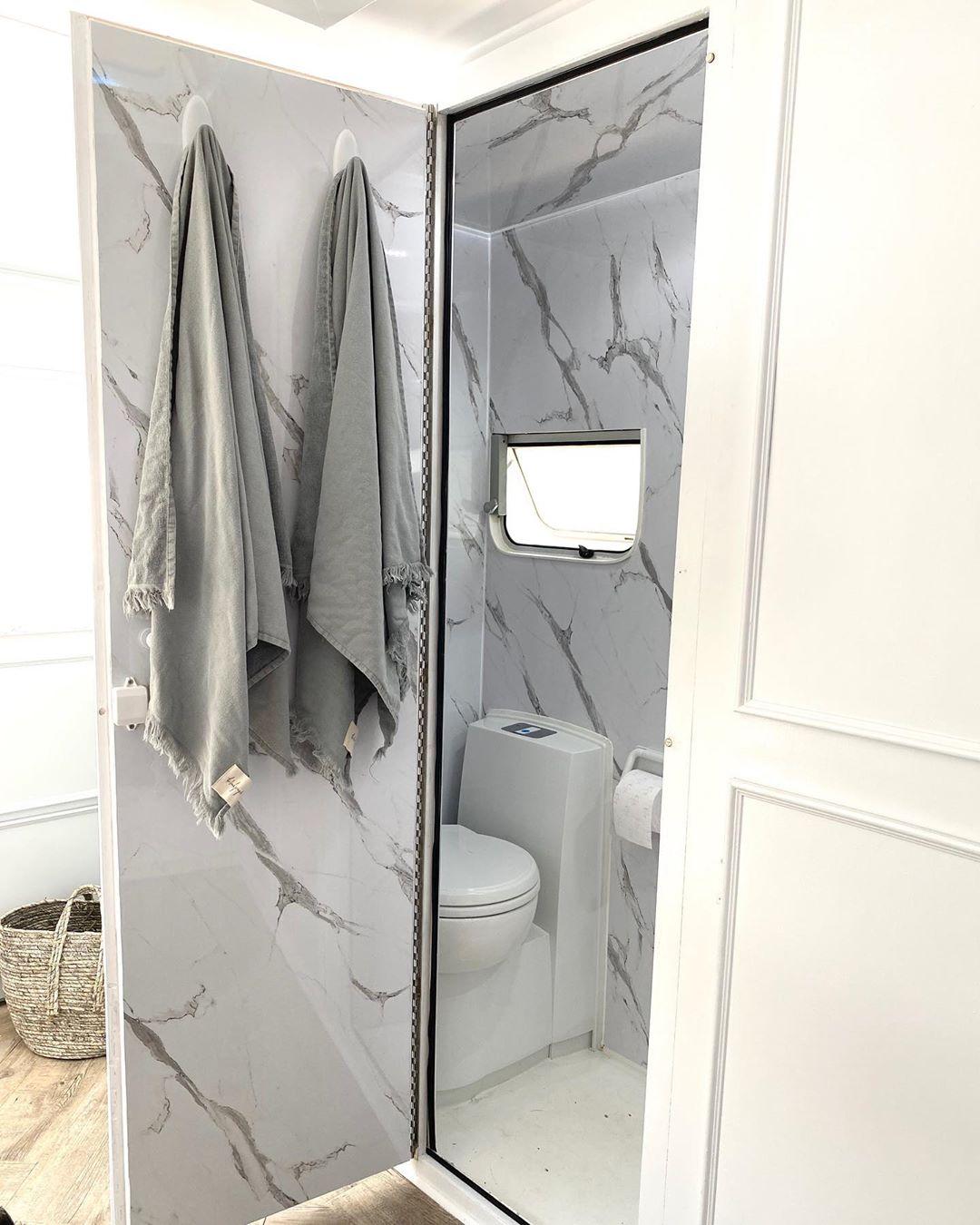 White and grey caravan bathroom interior