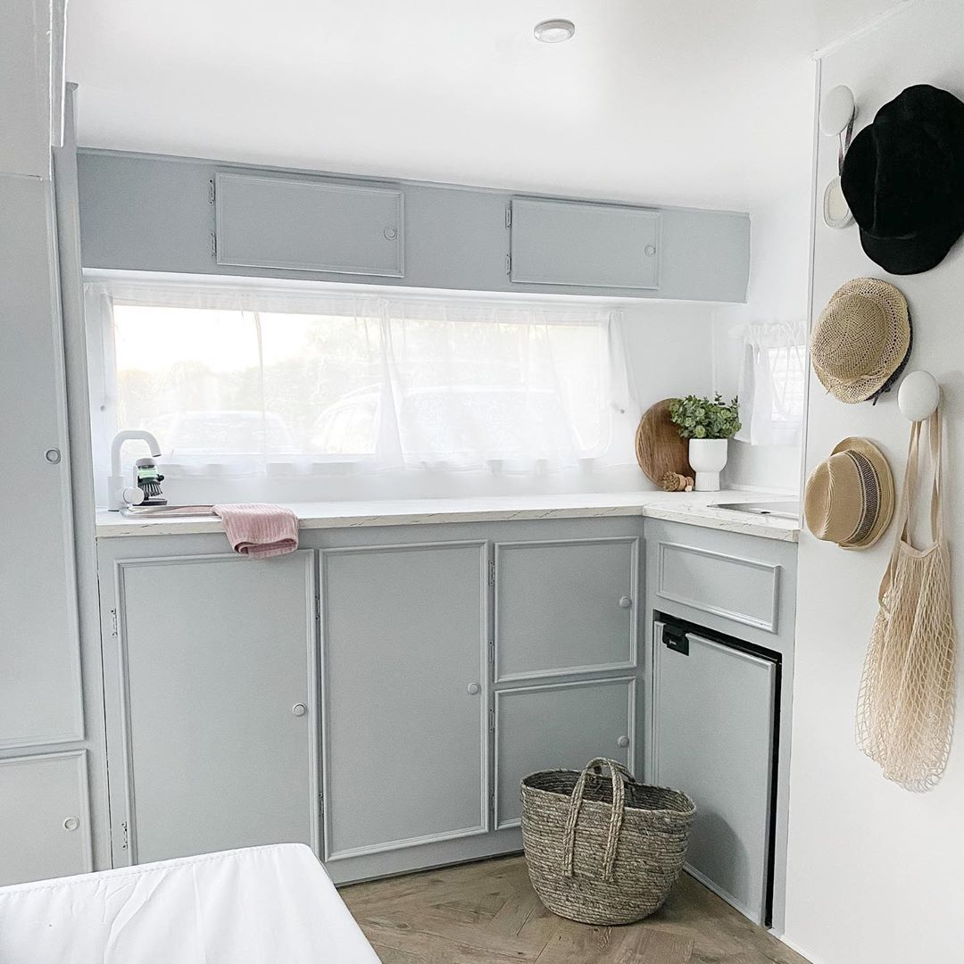 White and grey kitchen inside a vintage caravan (renovated)