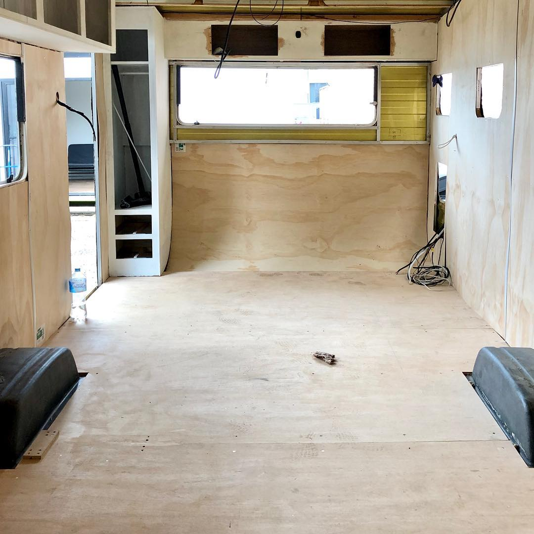 Interior of caravan mid-way through renovation with ply on the walls.