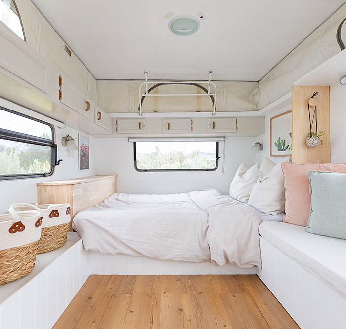 Light and white interior of a renovated vintage caravan