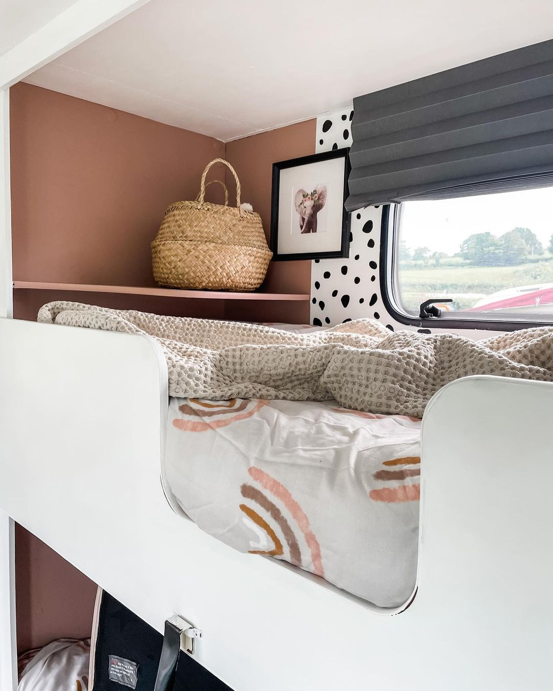 Double bunks inside a renovated caravan.