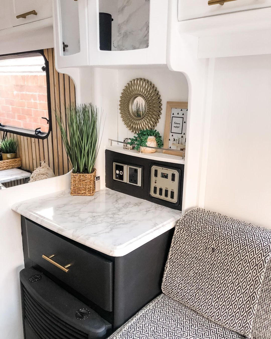 Decor details in a renovated caravan showing a new countertop.