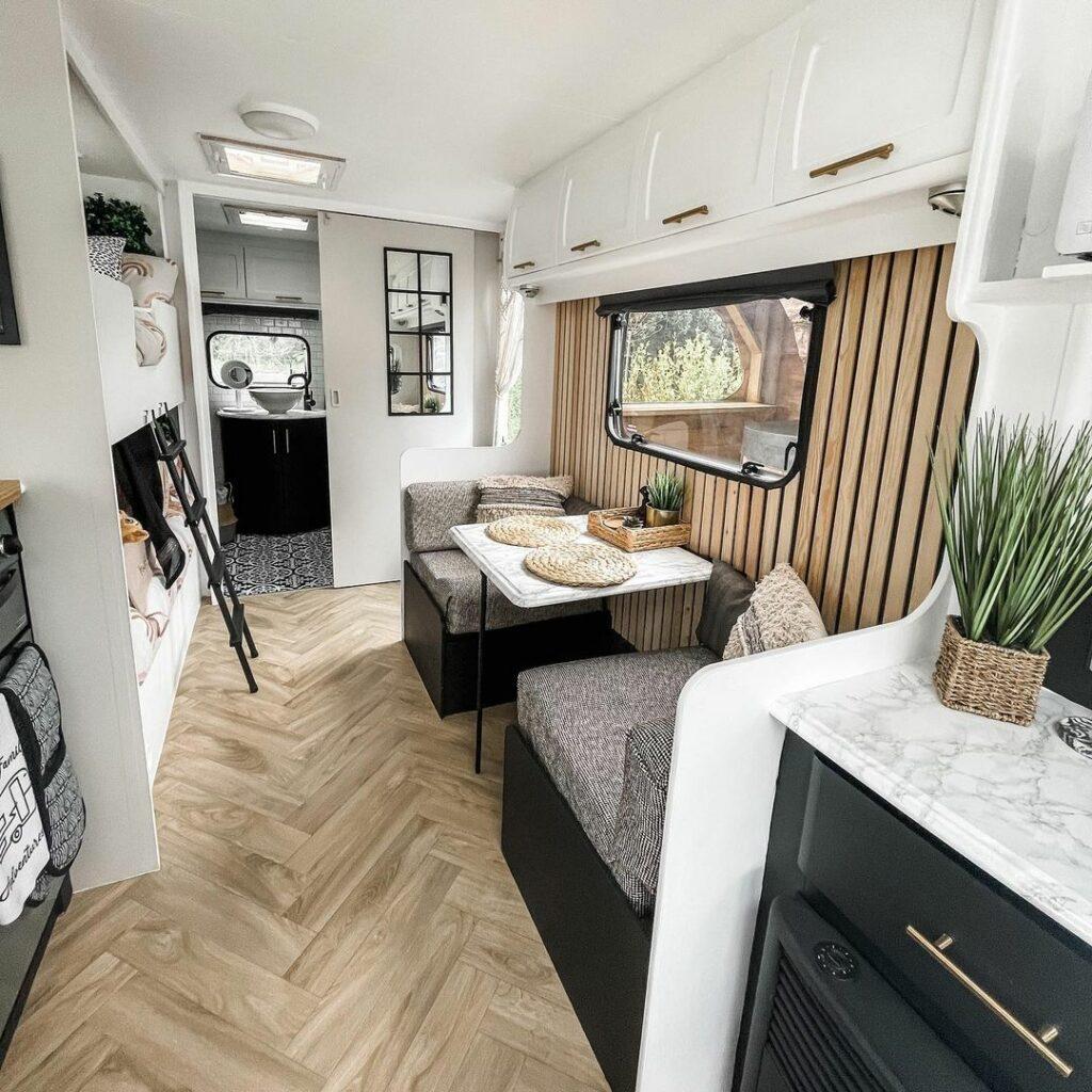 Light interior of a renovated caravan showing neutral decor.