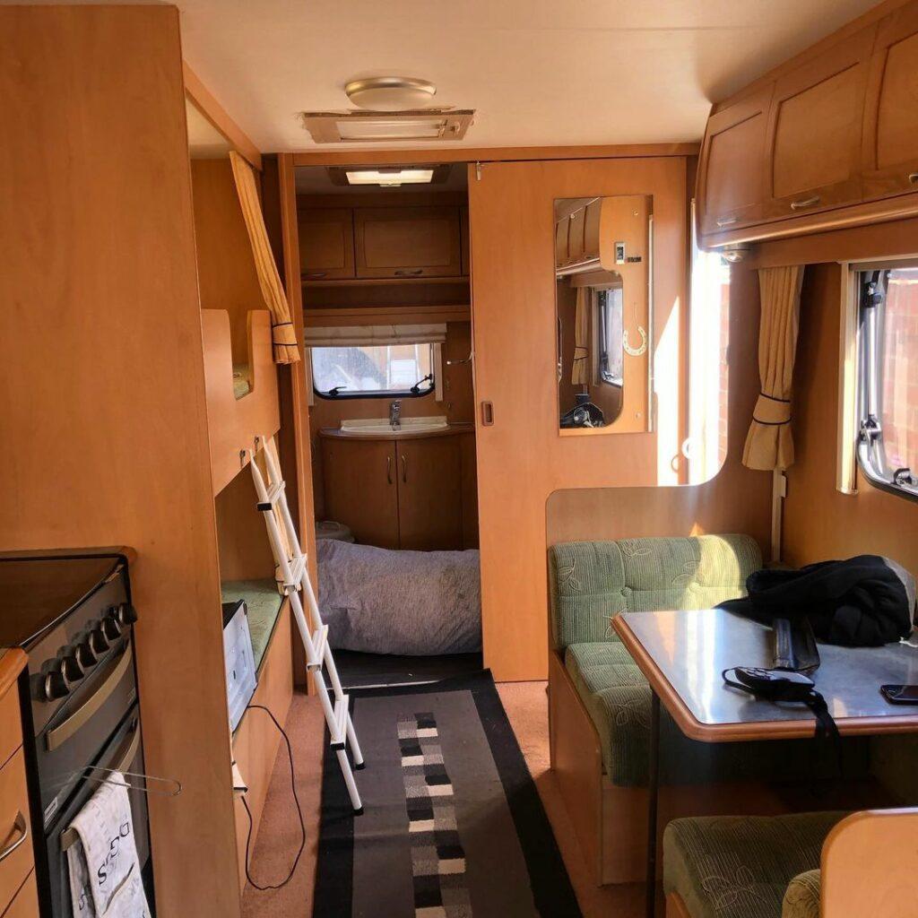 Brown interior of a caravan before renovation.