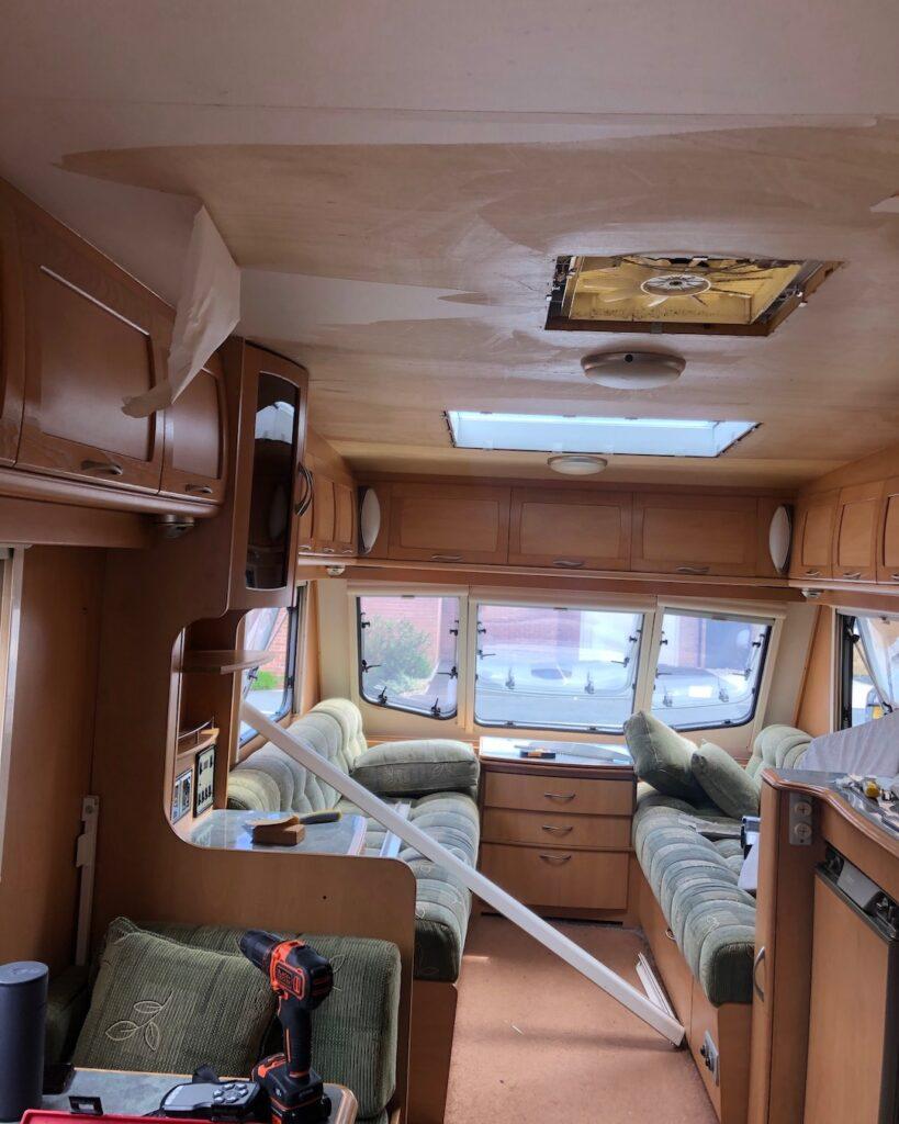 Partly demolished interior of caravan before renovation.
