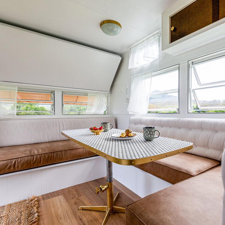 Dining area inside a renovated retro caravan.