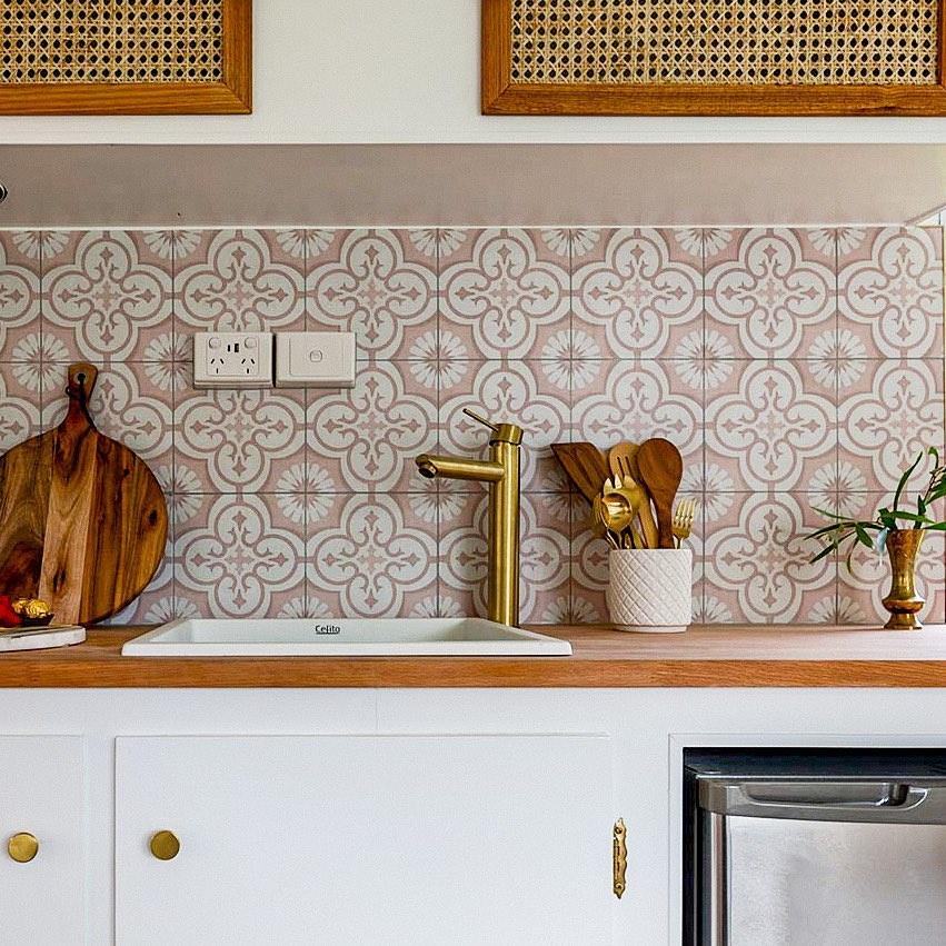 Small kitchen in a vintage caravan, with retro style backsplash.